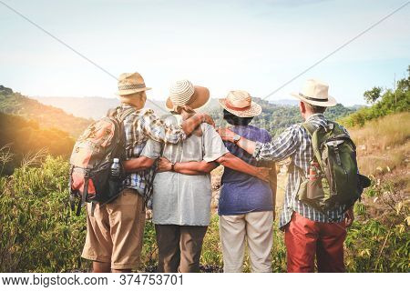A Group Of Asian Seniors Hiking And Standing On High Mountains Enjoying Nature. Senior Community Con