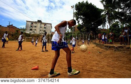Salvador, Bahia / Brazil - December 21, 2015: Young People Are Seen Playing Sports On The Ground Foo