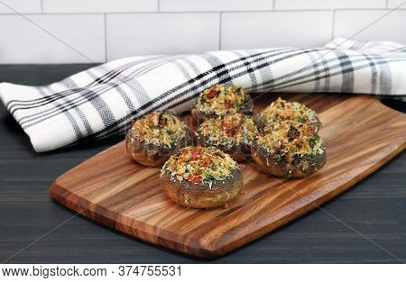 Fresh Baked Stuffed Mushrooms With Sundried Tomatoes, Breadcrumbs And Parmesan Cheese.