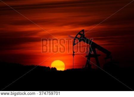 Red Coloured Sky With Beautiful Sunset In An Industrial Area