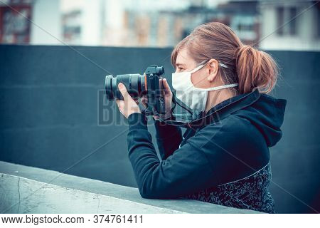 female photographer during a pandemic