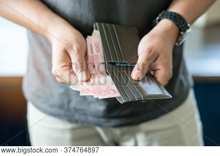 Man Holding Wallet With Full Of Money Prepare For Spend.
