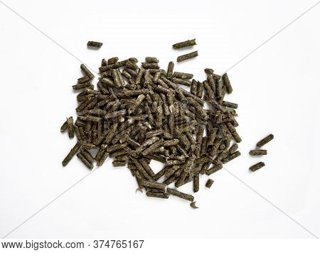 Food Green Pellets For A Domestic Rodent On A White Background. Hamster, Rabbit, Guinea Pig, Mouse,