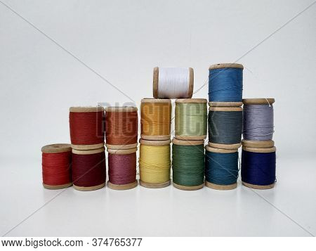 Colored Spools Of Sewing Thread On A White Background. Sewing Masks, Clothes, Multi-colored Rainbow-