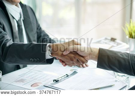 Entrepreneur Signed Contract Loan Financial. Young Businessman And Financial Agent Shaking Hands Tog