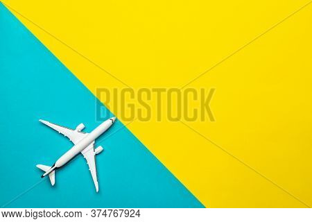 Play Airplane White Toy In Flight Travel Concept. Sky Air Plane Or Aircraft On Fly Yellow And Bright