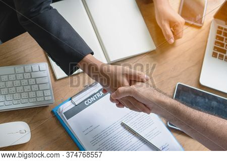 Business Partners Confirm Corporation. Young Startup Businessman Shaking Hands With Supplier / Clien