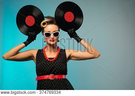 A Photo Of Glamorous Pin-up Girl Holding Vinyl Lp In Hand - Image