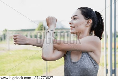 Young Woman Stretching Body After Jogging, Female Stretches Body. Portrait Of Beautiful Girl Close-u