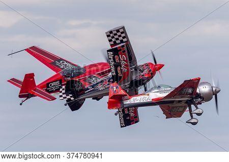 Avalon, Australia - February 28, 2015: Aerobatic Pilots Melissa Pembertonin An Extra 300, Skip Stewa