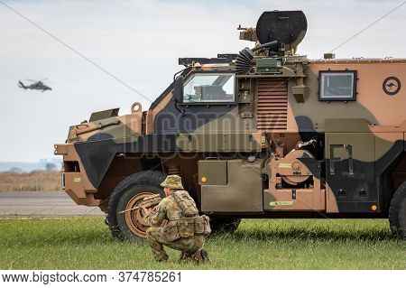 Avalon, Australia - February 27, 2015: Australian Army Soldier With A Bushmaster Armored Personnel C