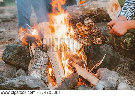 Cooking On A Campfire In Nature. Rest From The City Bustle In A Campsite