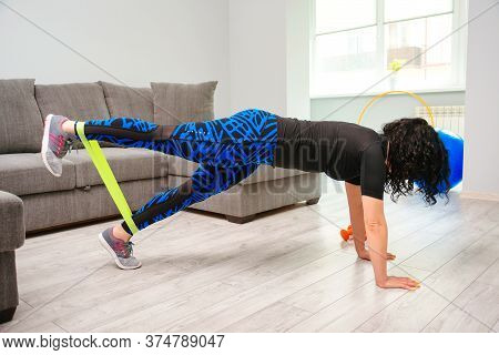 Home Workout With Resistance Band. Girl Training At Home. Sports Woman Exercising With Resistance Ba