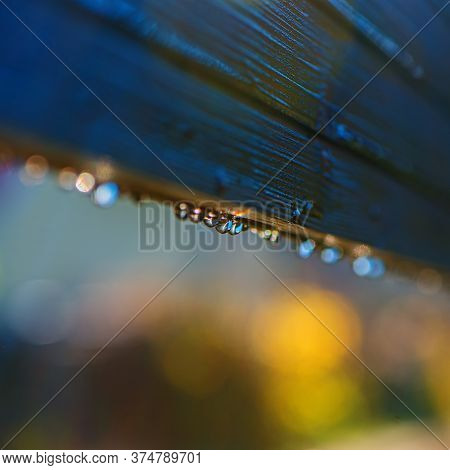 Wooden Railing Covered With Dew Drops On On A Blurred Natural Background.web Banner.