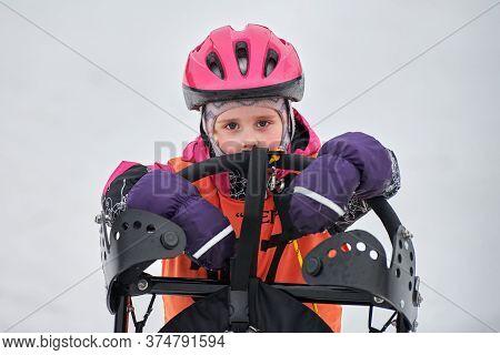 Verkhoshizhemye, Russia - 03.07.2020 - Little Girl On Sled. Kids Junior Sled Dog Racing. Winter Dog