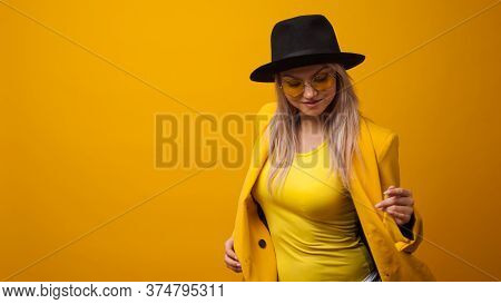 Cheerful Trending Young Woman In Bright Clothes On Yellow Background, Copy Space. Cool Blonde Girl I