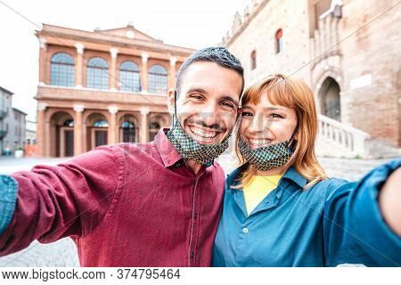 Happy Boyfriend And Girlfriend In Love Taking Selfie With Face Masks At Old Town Tour - Wanderlust L