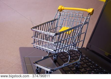 End Of Online Sales, Concept. Online Shopping, Shopping Cart On Laptop Keyboard. Shopping In Online