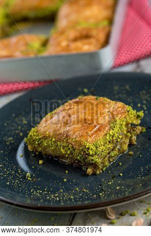 Traditional Turkish Dessert In Plate On Wooden Table