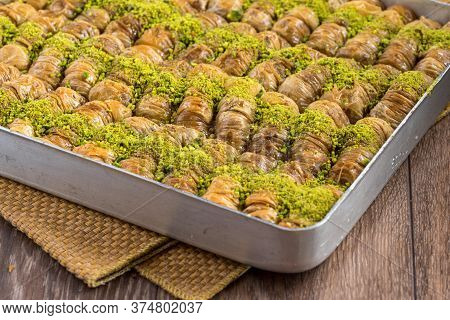 Traditional Turkish Dessert In Tray On Wooden Table