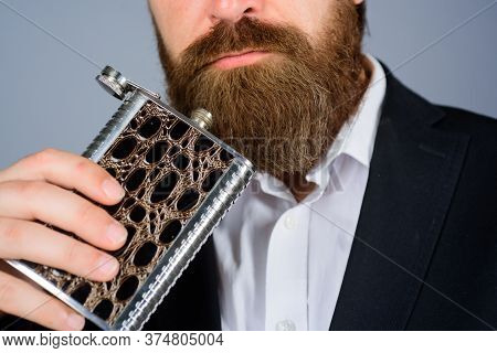 Bearded Hipster Wear Elegant Suit Hold Metal Flask For Alcohol. Man With His Booze Flask. Gentleman