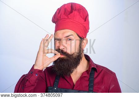 Professional Chef Man Showing Sign For Delicious. Winking Bearded Chef, Cook Or Baker Gesturing Exce