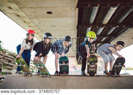 Extreme Sport In City. Skateboarding Club For Children. Group Friends Posing On Ramp At Skatepark. E
