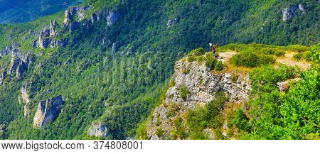 woman hiking canyon in cevennes national park- France, adventure, extreme sport concept