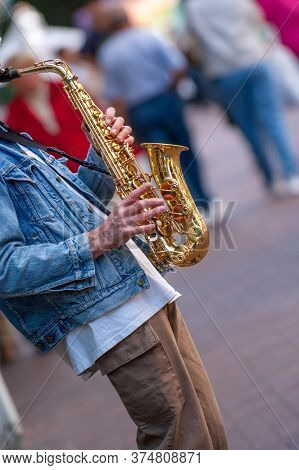 Street Sax Player On A Sidewalk In Vancouver, Canada
