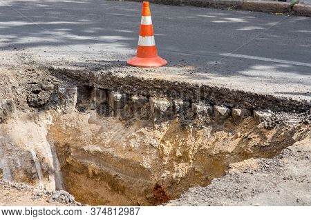 The Road Repair Work And Caution With Blocked Barrier Over Concrete Digging.