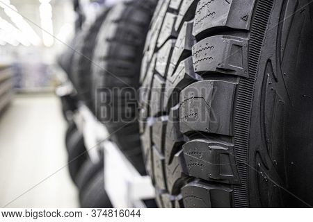Closeup Shot Of Tread And Block Pattern On A Car Tire