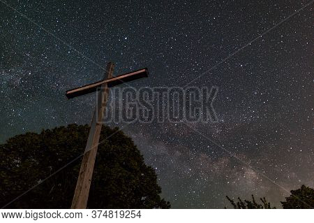 Cross Reaching Clear Spangled Sky At Night