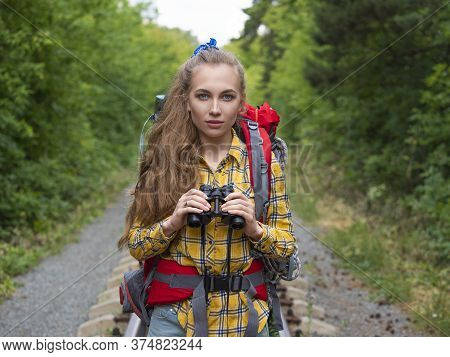 Hiker Woman With Binokular Looking At Camera. Lifestyle Portrait.