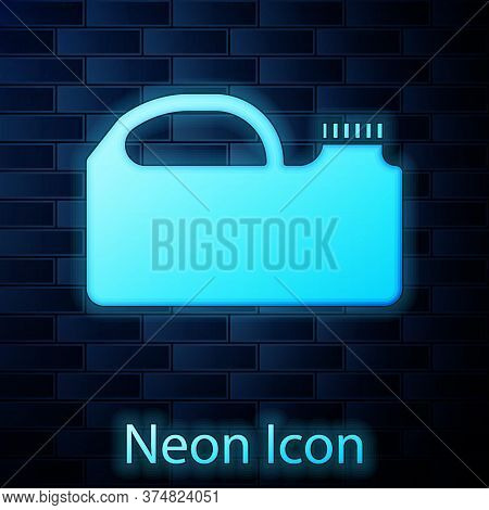 Glowing Neon Plastic Canister For Motor Machine Oil Icon Isolated On Brick Wall Background. Oil Gall