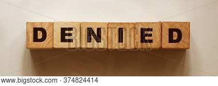 Wooden Blocks With The Text: Denied. Access Or Claim Rejected Business Concept