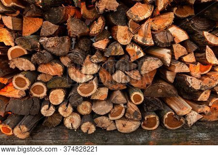 Firewood Background. Preparation Of Firewood For The Winter And Use For Cooking. Stacks Of Firewood