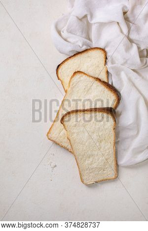 Sliced Homemade Hokkaido Wheat Toast Bread On White Cloth On White Texture Background. Flat Lay, Cop
