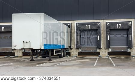 Trailer At Docking Stations Of A Distribution Centre Waiting To Be Loaded