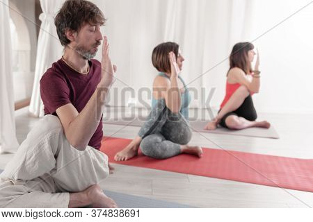 Yoga Teachers Performing Yoga In Matsyendrasana Pose - Lord Of The Fishes Pose. Group Of People Prac