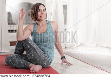 Portrait Of Woman Performing Yoga In Matsyendrasana Pose - Lord Of The Fishes Pose.how To Keep Your