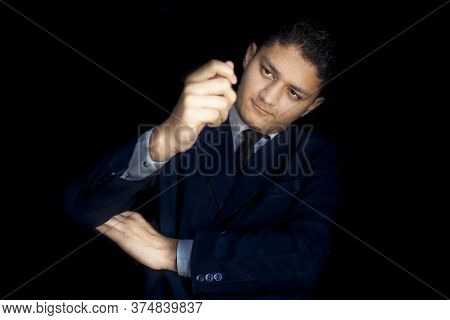 Portrait Shot Of A Businessman With Weird Expressions On His Face Isolated On A Black Colored Backgr