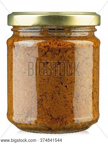 Closeup Of Jar With Dried Tomatoes Pesto. This Particular Pesto Is Prepared By An Italian Traditiona
