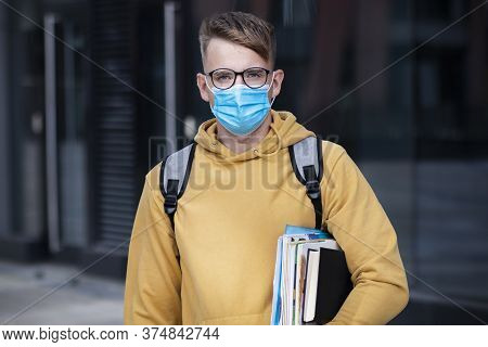 Guy Student, Pupil Boy, Young Man In Protective Medical Mask And Glasses On Face Outdoors University