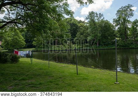 Clothesline With Hanging Laundry On The River Trave In The Old Town Centre Of The Hanseatic City Lue