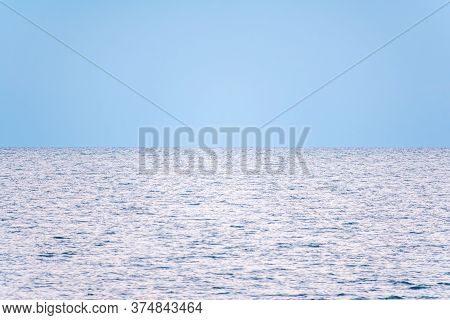 Background Of Sky And Sea, Sea Is Very Calm With Gentle Ripples, Sky Perfectly Clear. Calm Sea And B