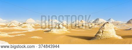 White Desert At Farafra In The Sahara Of Egypt. Web Banner In Panoramic View.