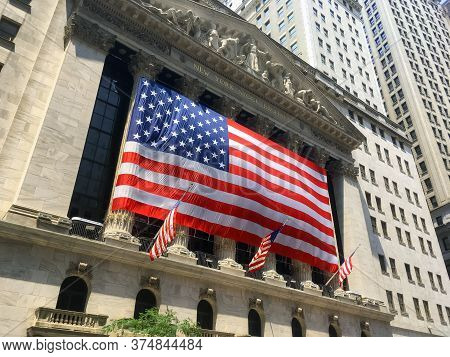 New York-july 3: A Very Large American Flag Drapes The New York Stock Exchange On July 3 2018 In Low