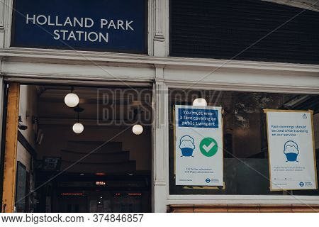 London, Uk - June 20, 2020: Face Covering Signs By The Entrance To Holland Park London Underground S