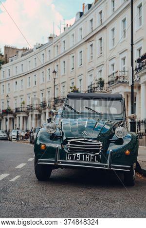 London, Uk - June 20, 2020: Close Up Of An Old Citroen 2cv Parked On A Street In Holland Park, An Af