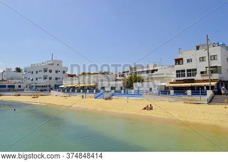 Fuerteventura, Canary Islands, Spain - September 21, 2018 : Tourists On Corralejo Beach In Fuerteven